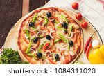 italian pizza  on a wooden tray | Shutterstock . vector #1084311020