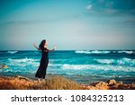 lonely inspired woman in black...   Shutterstock . vector #1084325213