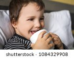 sick smiling small baby boy...   Shutterstock . vector #1084329908