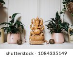 A Wooden Statue Of Ganesha The...