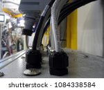 Small photo of Cables entering a control box at a synchrotron X-ray beamline.