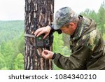 foresters install photo traps...   Shutterstock . vector #1084340210