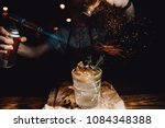 barman prepares cocktail with... | Shutterstock . vector #1084348388
