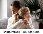 loving mother hugging cute... | Shutterstock . vector #1084354886