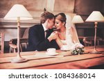 the newlyweds hug each other in ... | Shutterstock . vector #1084368014
