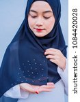 Small photo of Hijab women show her shawl material for muslimah