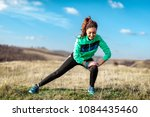 young fitness woman doing... | Shutterstock . vector #1084435460