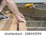 worker installing cedar deck | Shutterstock . vector #108443594