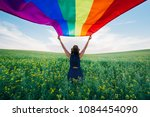 woman holding the gay rainbow... | Shutterstock . vector #1084454090