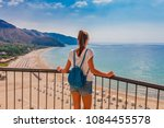 young tourist woman on the... | Shutterstock . vector #1084455578