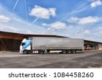 truck drives on the site of a... | Shutterstock . vector #1084458260