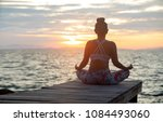 woman sitting in yoga... | Shutterstock . vector #1084493060