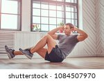 handsome fitness man in a t... | Shutterstock . vector #1084507970