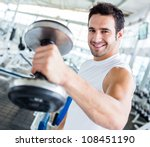 Strong Man At The Gym Lifting...