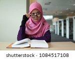 a beautiful muslimah student... | Shutterstock . vector #1084517108