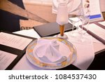 served table  with menu on it | Shutterstock . vector #1084537430