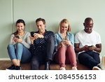 smiling group of diverse young... | Shutterstock . vector #1084556153