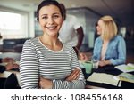 young businesswoman smiling and ... | Shutterstock . vector #1084556168