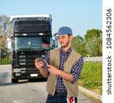 truck driver and truck   Shutterstock . vector #1084562306