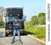 truck driver and truck | Shutterstock . vector #1084562309