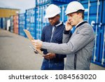 engineer standing with a... | Shutterstock . vector #1084563020