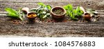 spices and herbs on wooden board | Shutterstock . vector #1084576883