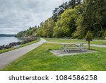 a view of lush trees along the... | Shutterstock . vector #1084586258