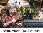 asian elder woman holding... | Shutterstock . vector #1084590536