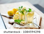 refreshing summer drink with... | Shutterstock . vector #1084594298
