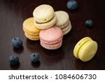 set of macarons on table with... | Shutterstock . vector #1084606730