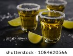 gold tequila with lime and salt ... | Shutterstock . vector #1084620566