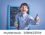 cheerful clever schoolboy with... | Shutterstock . vector #1084623524