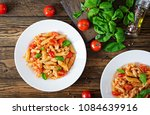 penne pasta in tomato sauce... | Shutterstock . vector #1084639916