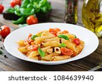 penne pasta in tomato sauce... | Shutterstock . vector #1084639940