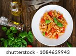 penne pasta in tomato sauce... | Shutterstock . vector #1084639943