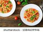 penne pasta in tomato sauce... | Shutterstock . vector #1084639946