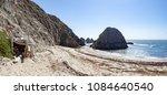 driftwood shelter on beach... | Shutterstock . vector #1084640540
