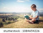 boy sitting and relaxing on a... | Shutterstock . vector #1084654226
