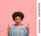 shocked mixed race dark skinned ... | Shutterstock . vector #1084664306