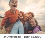 family friends taking selfie on ... | Shutterstock . vector #1084682090