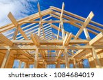 a frame of a house against a... | Shutterstock . vector #1084684019
