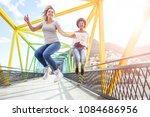 happy women friends jumping on... | Shutterstock . vector #1084686956