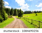 mountain road  surrounded with... | Shutterstock . vector #1084690256
