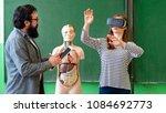young teacher using virtual... | Shutterstock . vector #1084692773