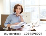 female lawyer working at table... | Shutterstock . vector #1084698029