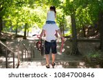 father and daughter walking... | Shutterstock . vector #1084700846