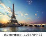 eiffel tower and bridge iena on ... | Shutterstock . vector #1084704476