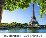 seine in paris with eiffel... | Shutterstock . vector #1084704506