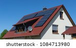 roof with solar panels or... | Shutterstock . vector #1084713980