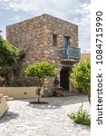 Small photo of SISSI, CRETE, GREECE - MAY 16, 2017: Located on lovely mile long sandy beach, Kalimera Kriti Hotel & Village Resort offers accommodation in three bungalow villages which surround a traditional square.